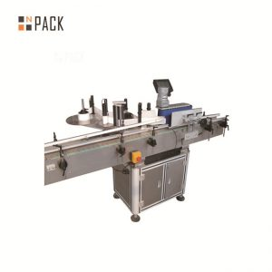Автоматска машина за обележување на картонски шишиња со налепници на горната површина